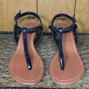 Twisted slip in and step out sandal